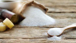 כפית גדושה סוכר עם קני ושק סוכר, על גאוט וסוכר